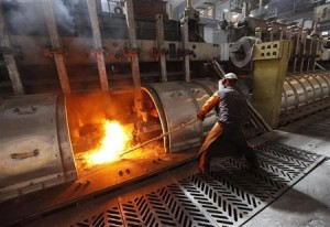 A worker operates an electrolysis furnace, which produces aluminium from raw materials, at the Rusal Krasnoyarsk aluminium smelter in the Siberian city of Krasnoyarsk